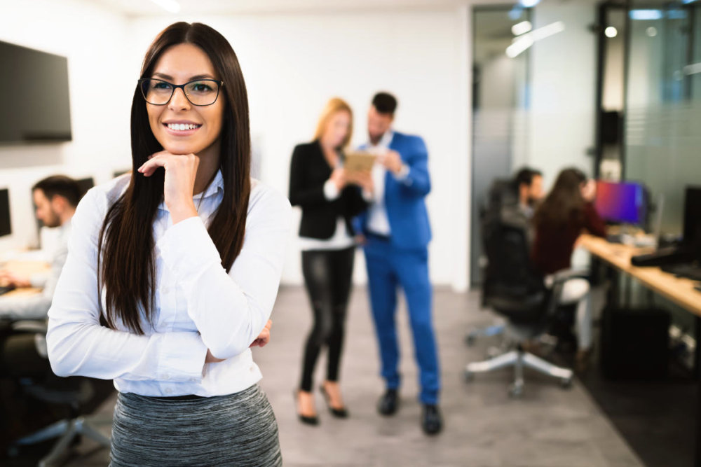 Portrait of female smiling company ceo in office   How To Know When To Quit Your Job: Reasons To Stay or Leave [INFOGRAPHIC]   should i quit my job   i quit my job