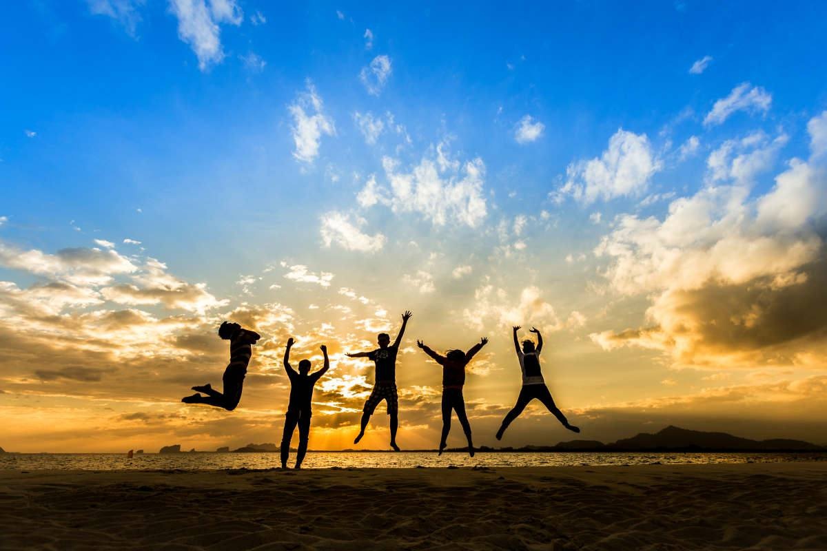 Business Team people jumping retreat together on the beach | Should I Go To College? | Ways To Know If College Is For You