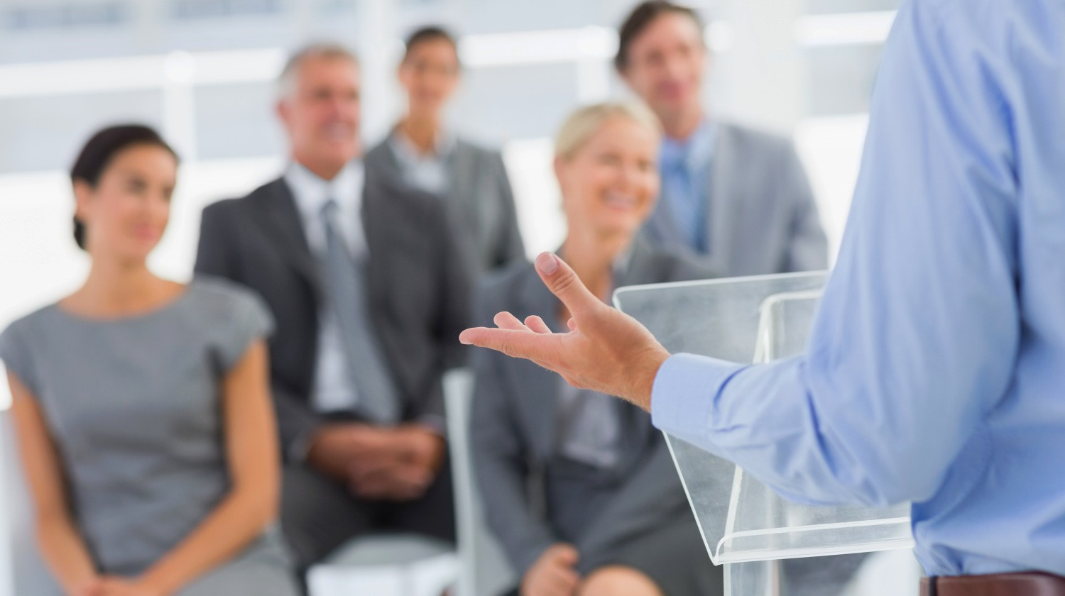 Featured | Businessman doing conference presentation in meeting room | Tips To Gain Confidence In Public Speaking