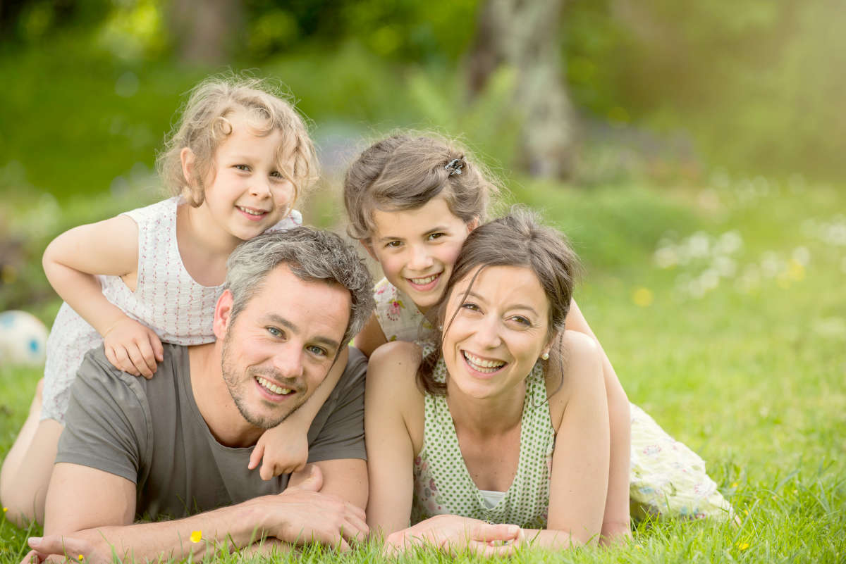 Cheerful family in a park | How Do You Handle Stress and Anxiety As An Entrepreneur?