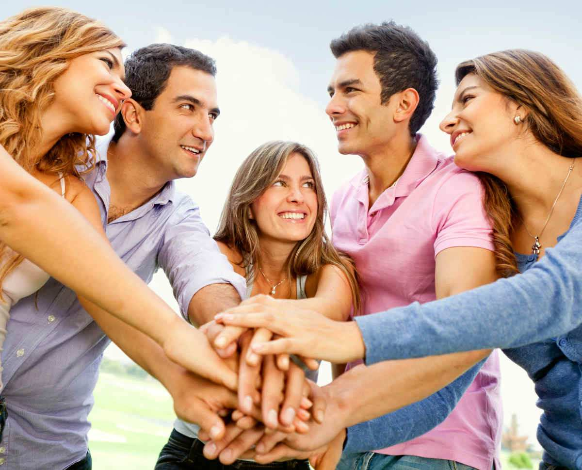 Group of young people with hands together | How To Deal With Failure and Turn It Into Success