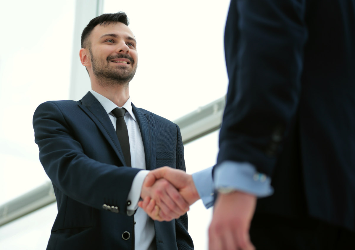 Handshake of business partners after a favorable trade deal | Life Lessons You'd Tell Your Younger Self | things i wish i knew before