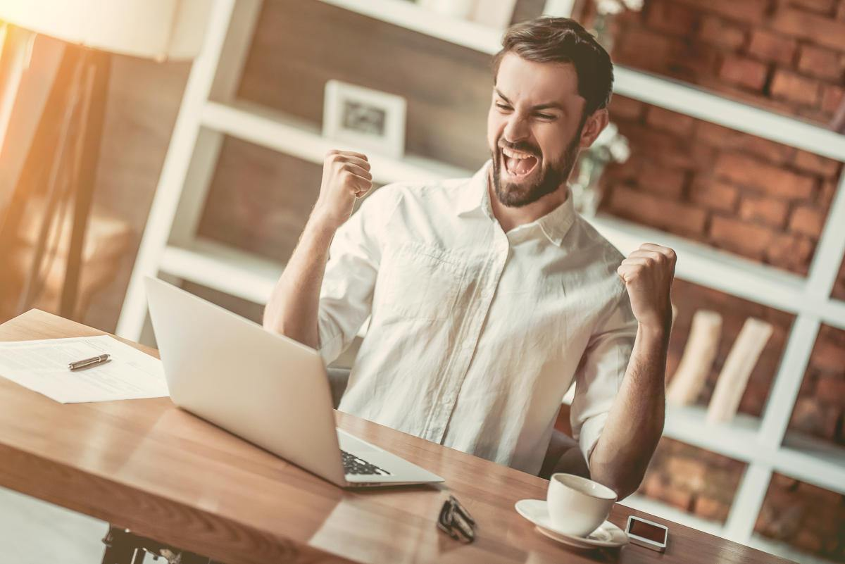 Happy handsome businessman is working with laptop in cafe | Ways Self Improvement Can Change Your Life and How To Do It