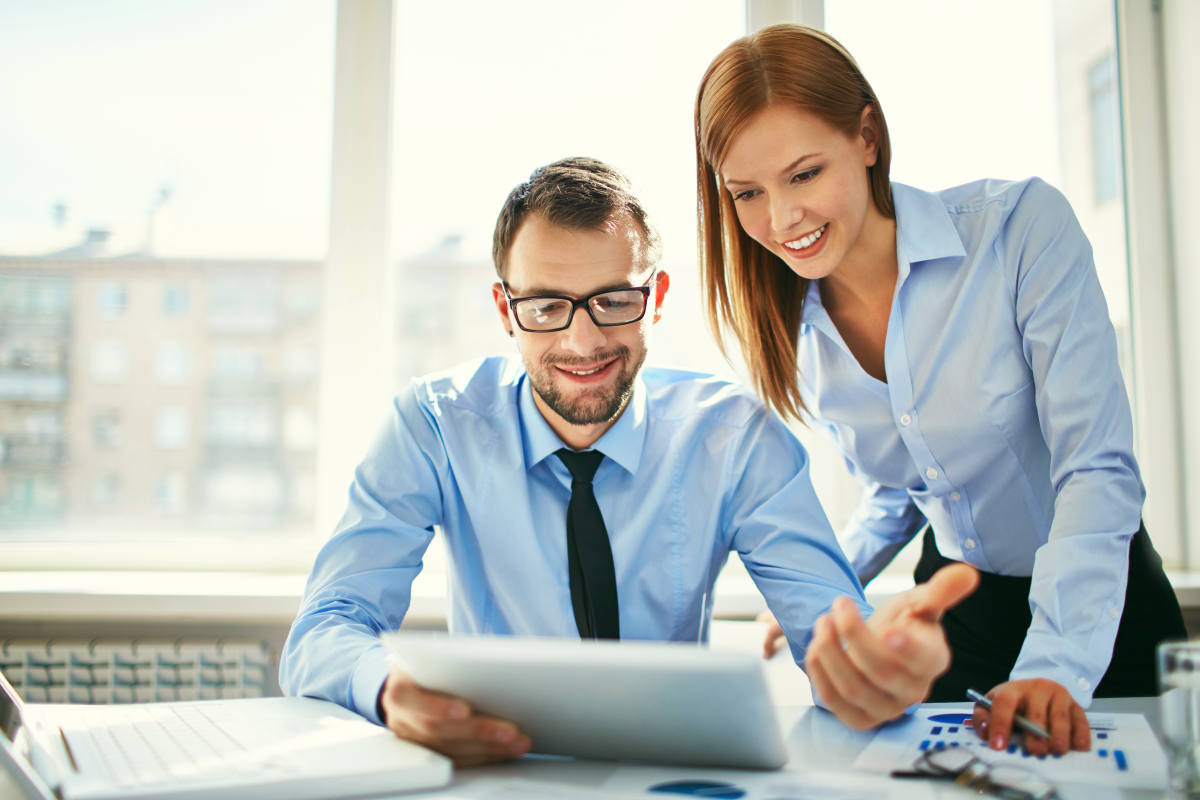 Two successful business partners working at meeting in office   How To Better Yourself: Practical Tips