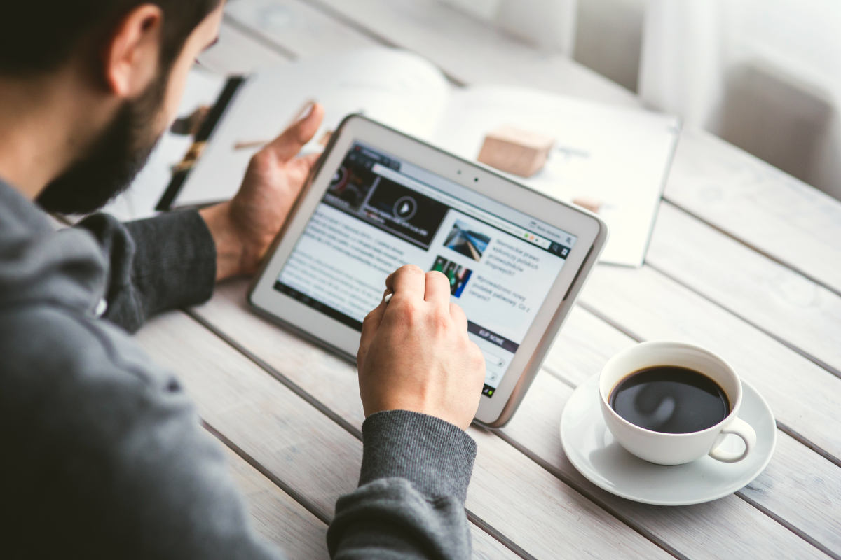 Man reading blog | How To Identify and Capture Market Trends For Your Business