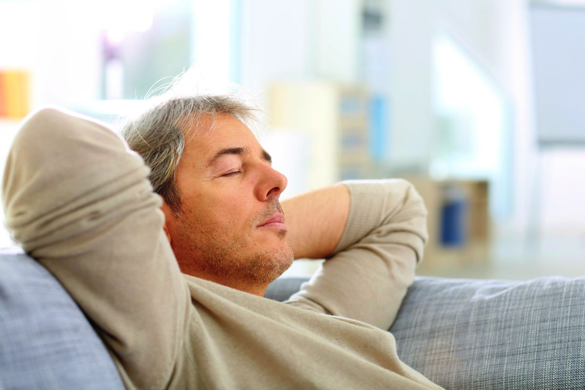 Man taking a nap in sofa at thome | How To Stay Productive In A World Full Of Distractions