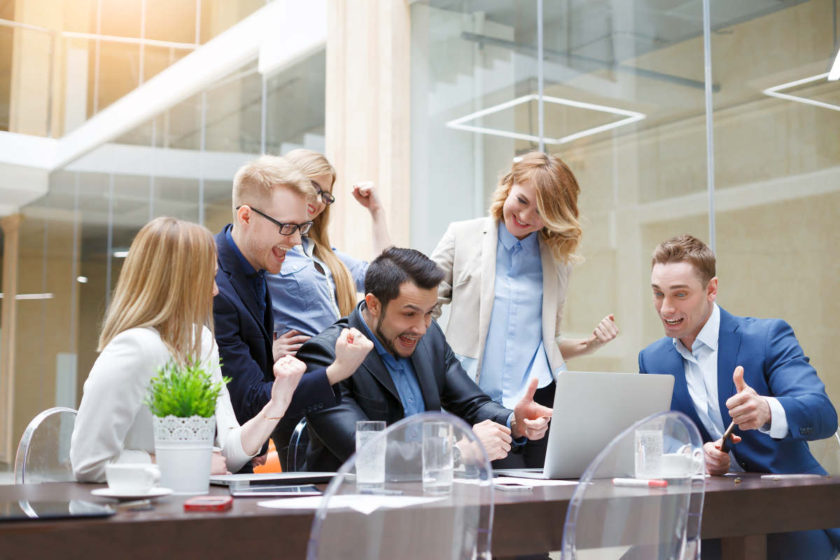 Happy business team enjoy good news together   How To Better Yourself: Practical Tips
