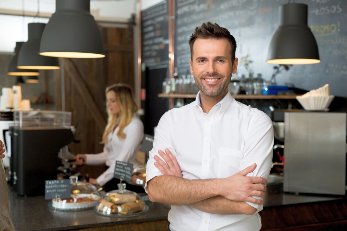 Successful small business owner standing with crossed arms | How to Reinvent Yourself and Improve Your Well-being