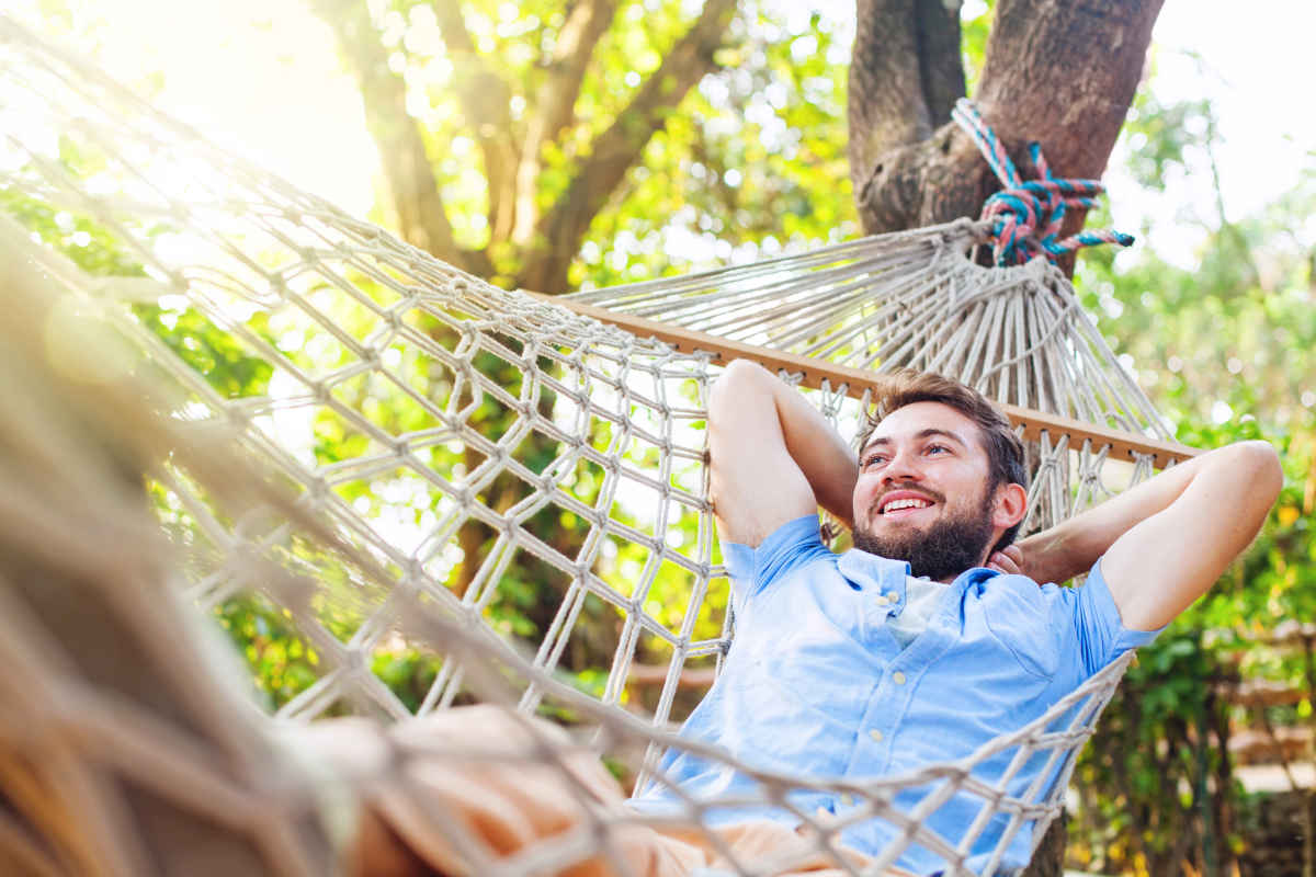 Young caucasian man swinging in a hammock   Why Do People Procrastinate And How Do You Beat It?   how to overcome procrastination