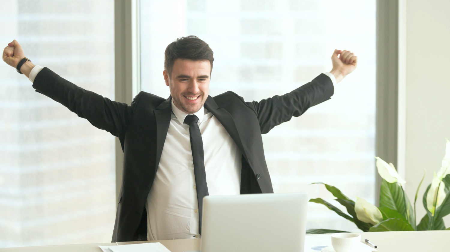 Happy businessman in suit raising hands looking at laptop | You Are Going To Be The Best At Anything You Do With These Tips | You Are The Best | how to be the best you | Featured