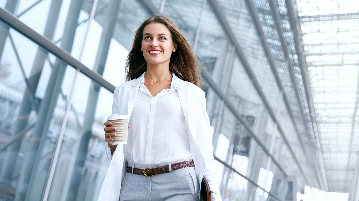 Successful Business Woman Holding Cup | How Can Doing Simple Actions Once A Day Improve Your Life? | trial | Featured | eating once a day