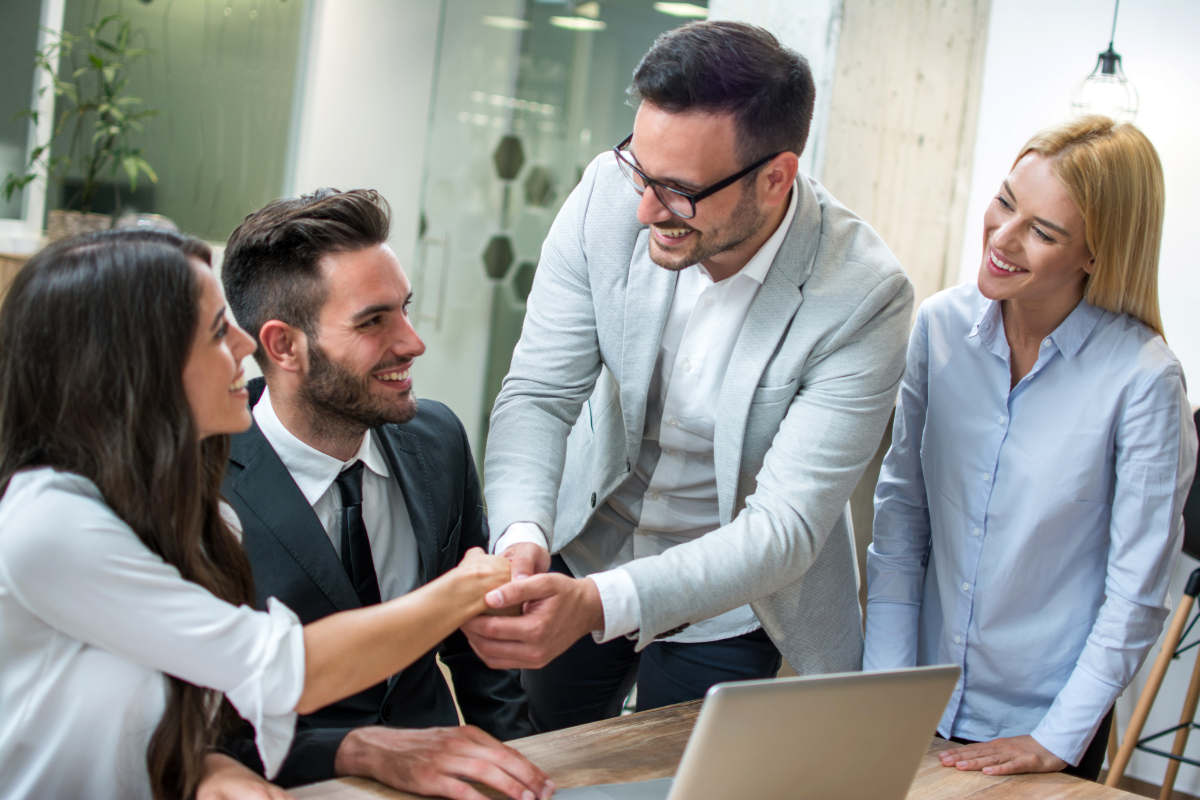 Business people shaking hands after successful meeting in modern office   How To Become A Superhero In Real Life   make yourself a superhero