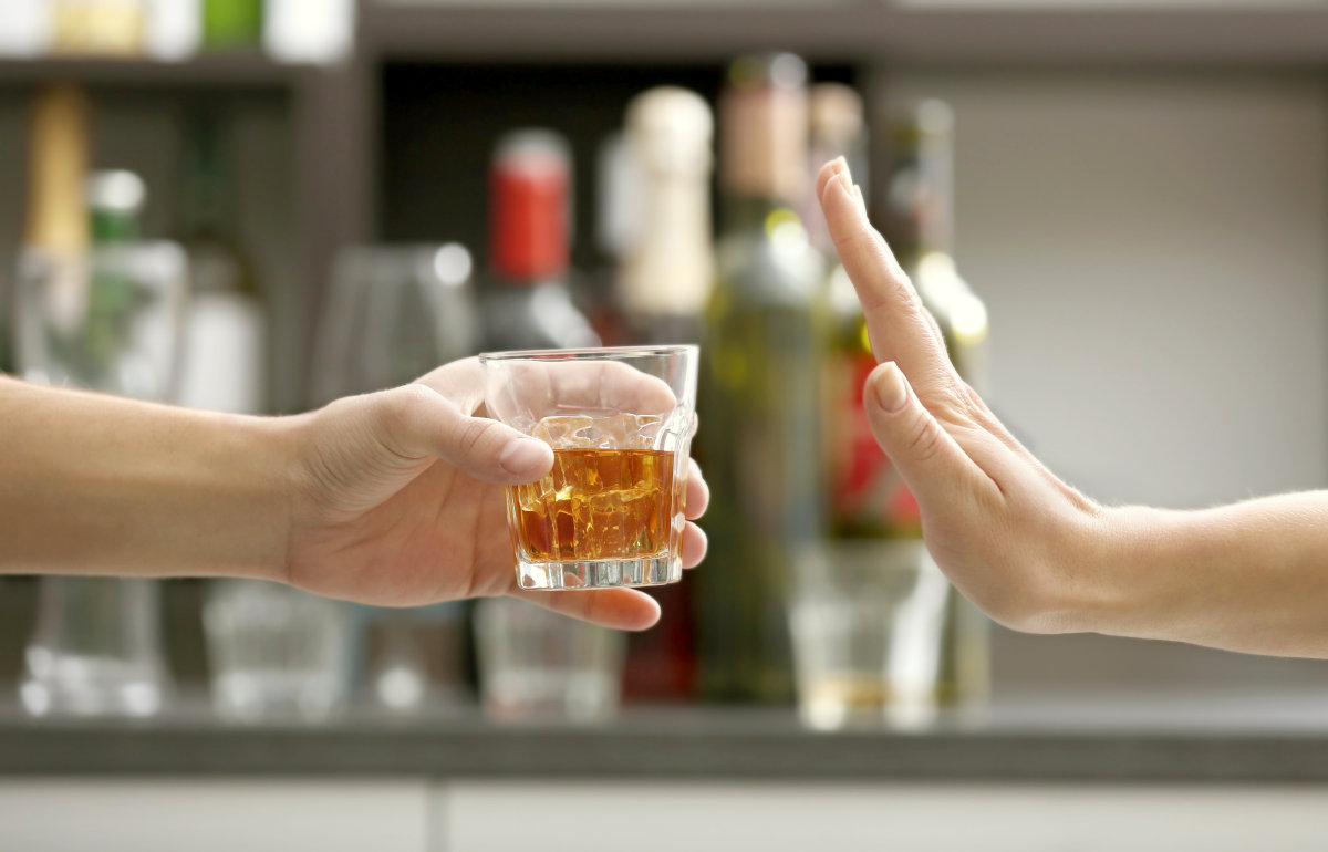 Hand rejecting glass with alcoholic beverage | Ways To Live Life With No Regrets | no regrets meaning