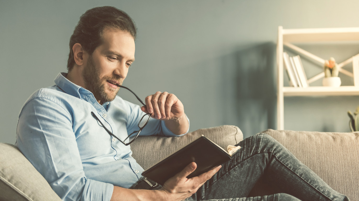 Handsome businessman is reading a book | Characteristics of Highly Intelligent People | Highly Intelligent People Characteristics | signs of highly intelligent people | Featured