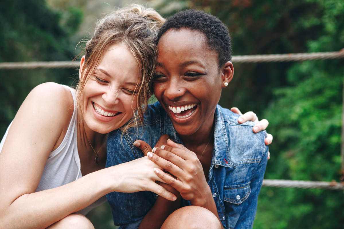 Happy friends holding each other | How Can Doing Simple Actions Once A Day Improve Your Life? | regimens | once a day abbreviation