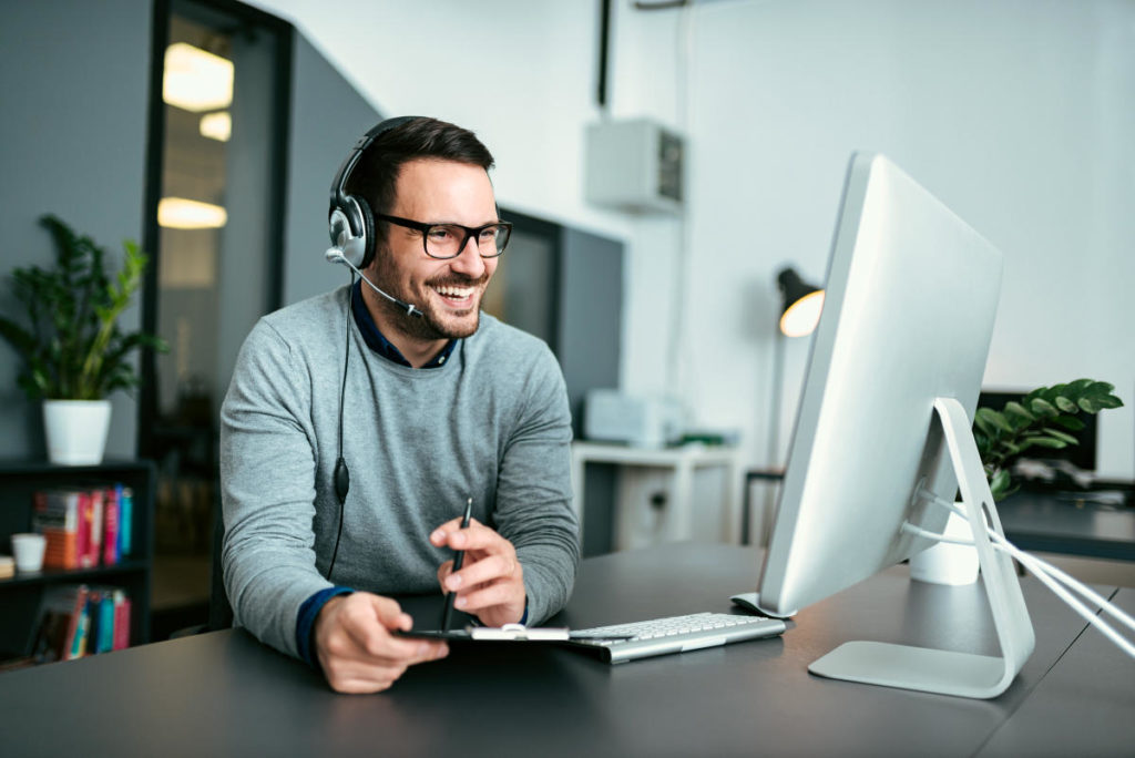 Casual smiling businessman using headset   Eventual Millionaires Mindset And Habits   millionaire habits book
