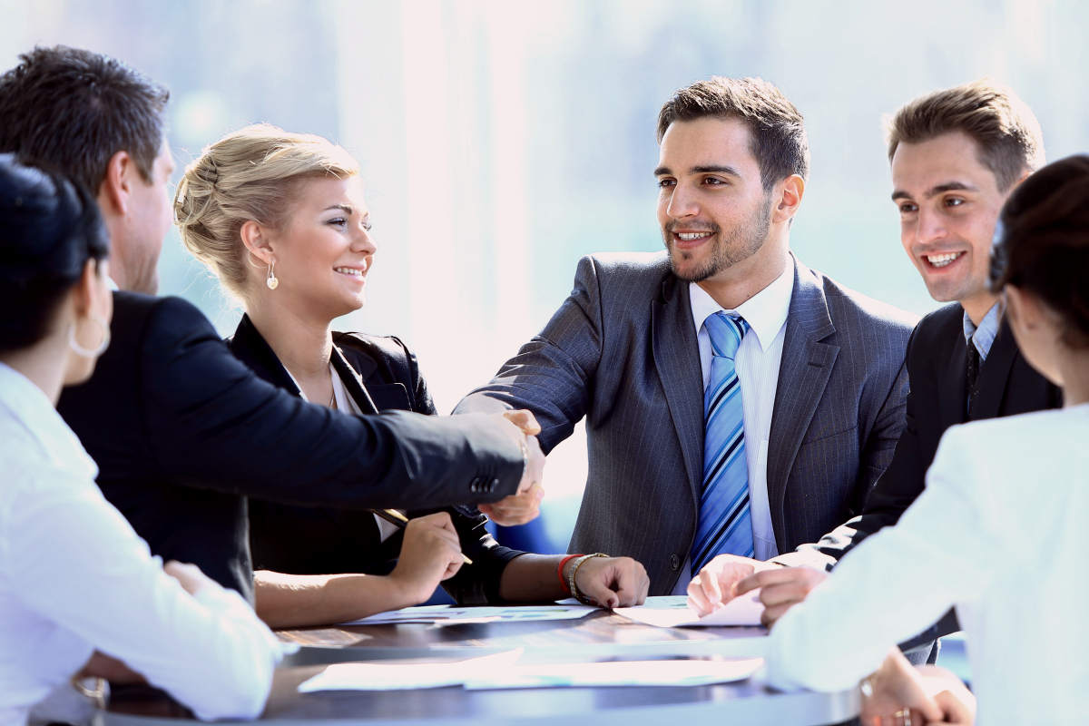 Two business colleagues shaking hands during meeting | You Are Going To Be The Best At Anything You Do With These Tips | You Are The Best | you're the best around