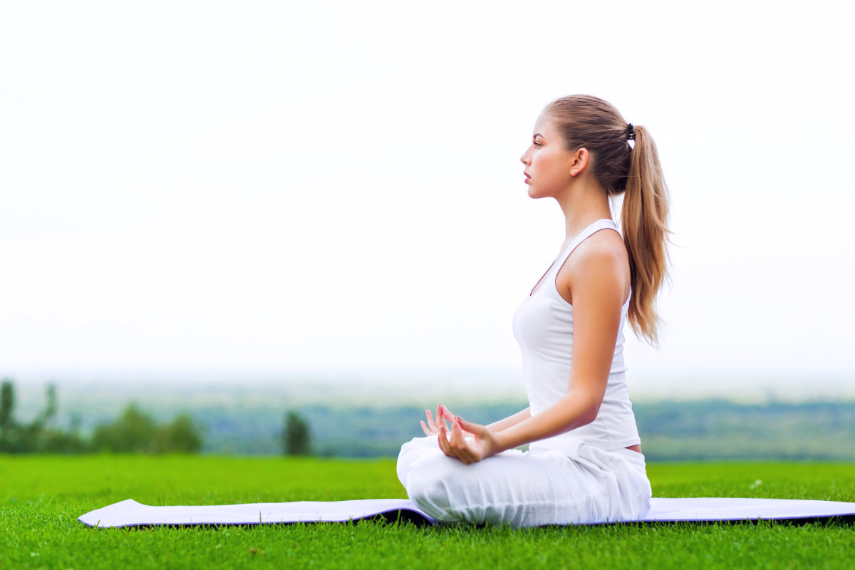 young-girl-doing-yoga-outdoor | Stress Management Activities To Loosen Up | natural stress relief meditation