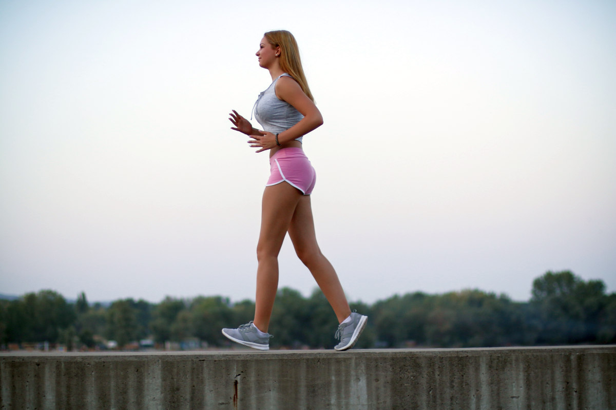 Young sportswoman brisk walking outdoors | How Can Doing Simple Actions Once A Day Improve Your Life? | dose | once a day medical