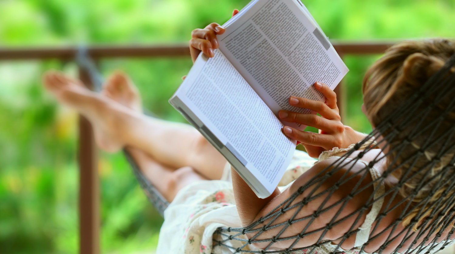 Young woman reading a book lying in hammock | Inspirational Books You Should Start Reading NOW | best books of all time | Featured