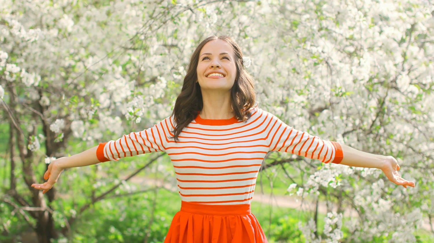 Beautiful happy young woman enjoying smell in a flowering spring garden | Reasons Why Self-Empowerment Is Important | How You Can Empower Yourself | women empowerment | Featured