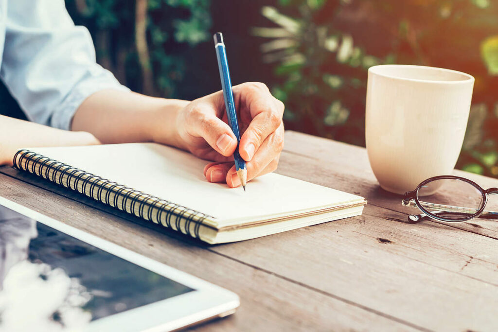 woman-hand-pencil-writing-on-notebook-great-ideas | How To Generate Great Ideas and Become An Idea Machine