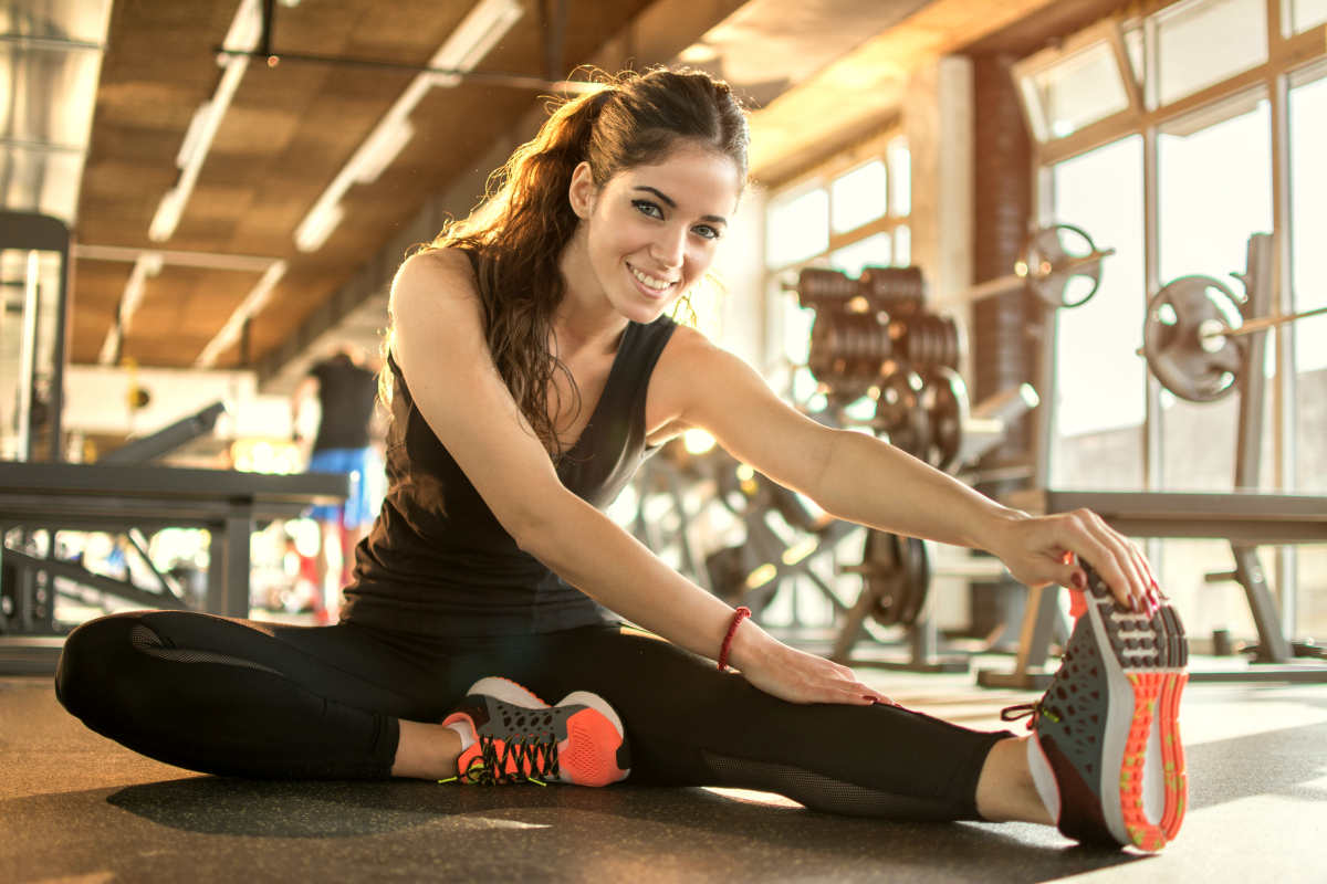 Young sporty woman stretching at gym | Mini Habits You Can Do In 20 Minutes To Be One Percent Better | practise