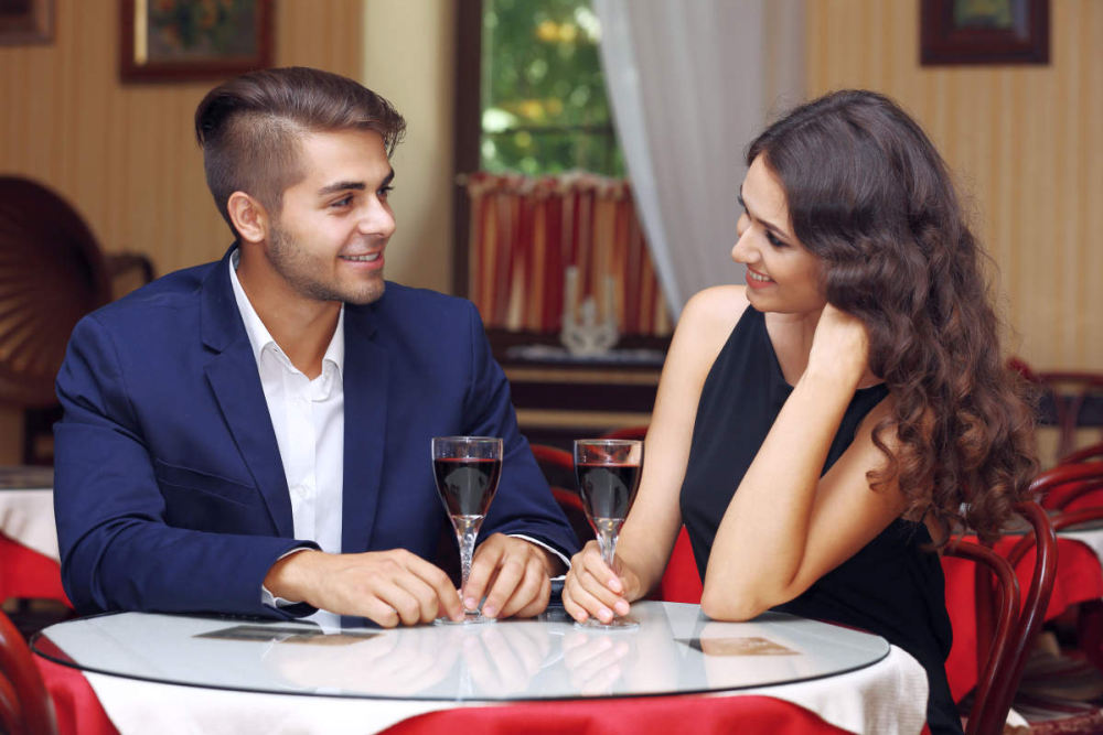 Attractive young couple dating at the restaurant | How To Be A Better Husband | how to be a good husband | effort