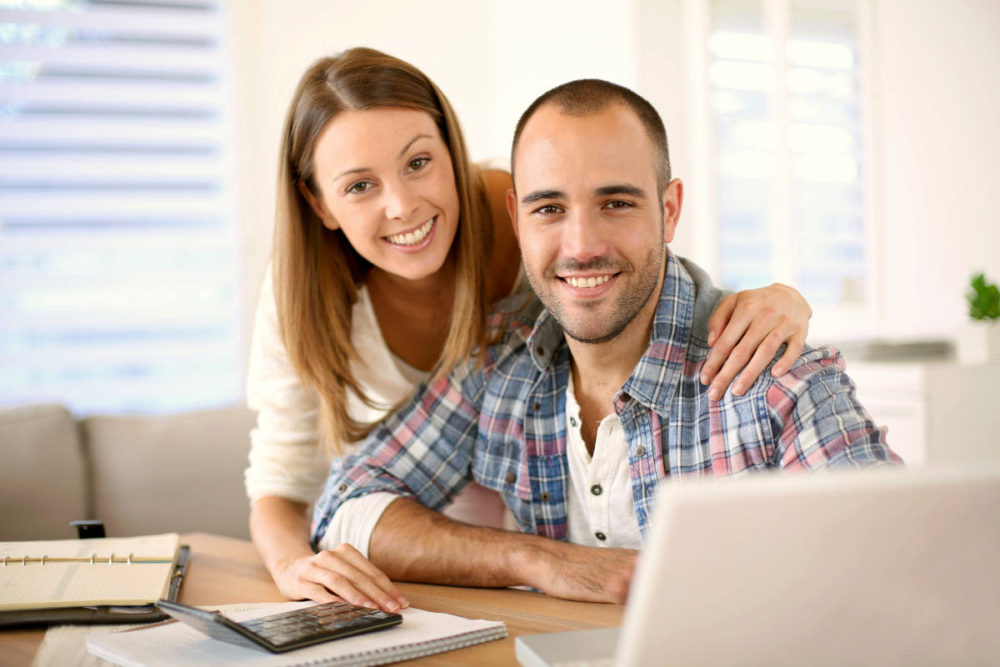 Young cheerful couple calculating savings for home investment | How To Be A Better Husband | how to be a better husband and father | advice