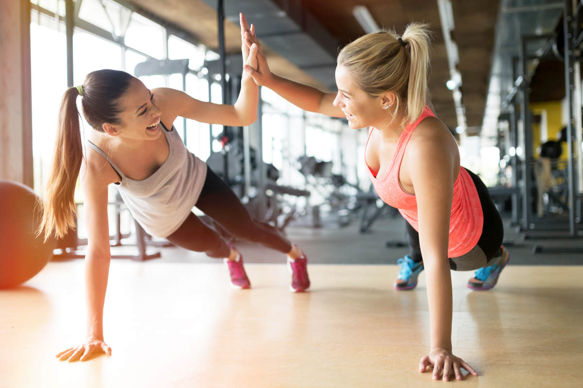 Beautiful women working out in gym together | Life Skills To Master Before 40 | young adults