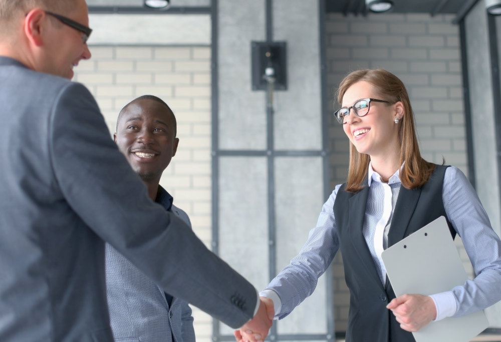 Business people shaking hands, finishing up a meeting | Why Is Emotional Intelligence Important? | why emotional intelligence is important
