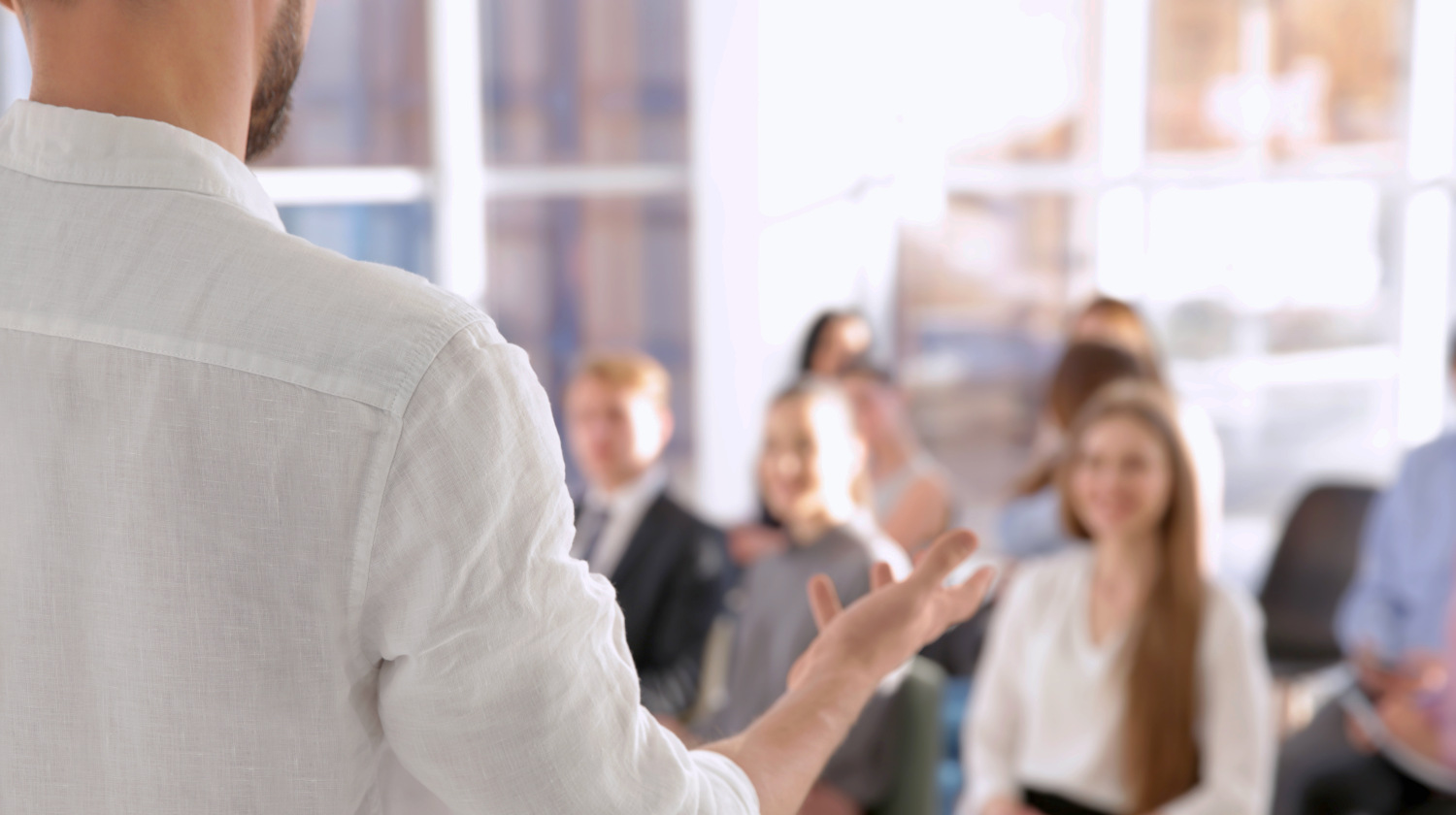 Business trainer giving presentation to group of people | Leadership Lessons From Don Draper To Be A Better Leader | what leaders really do | Featured