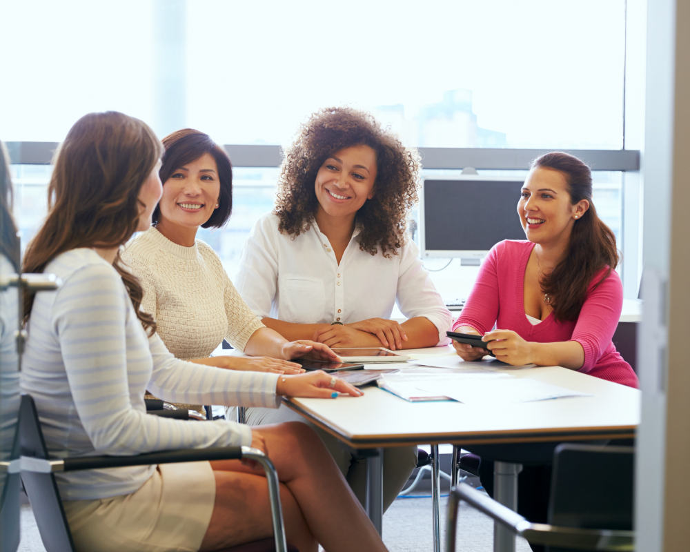 Casually dressed female colleagues talking in a meeting room | The Keys to Success You Never Knew You Needed | 8 keys to success