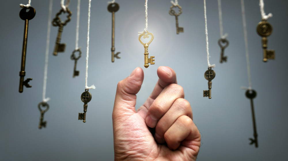 Choosing the key to success from hanging keys | The Keys to Success You Never Knew You Needed | how to be successful | Featured