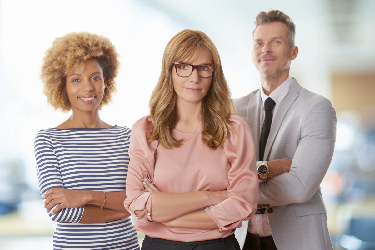 Confident middle aged businesswoman standing with arms crossed | Leadership Lessons From Don Draper To Be A Better Leader | what is leadership in business