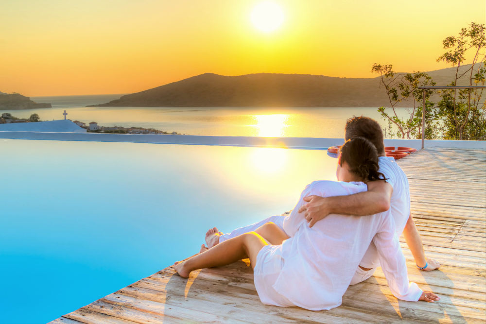 Couple in hug watching together sunrise in Greece | Reasons Why You Should Think Big | creating