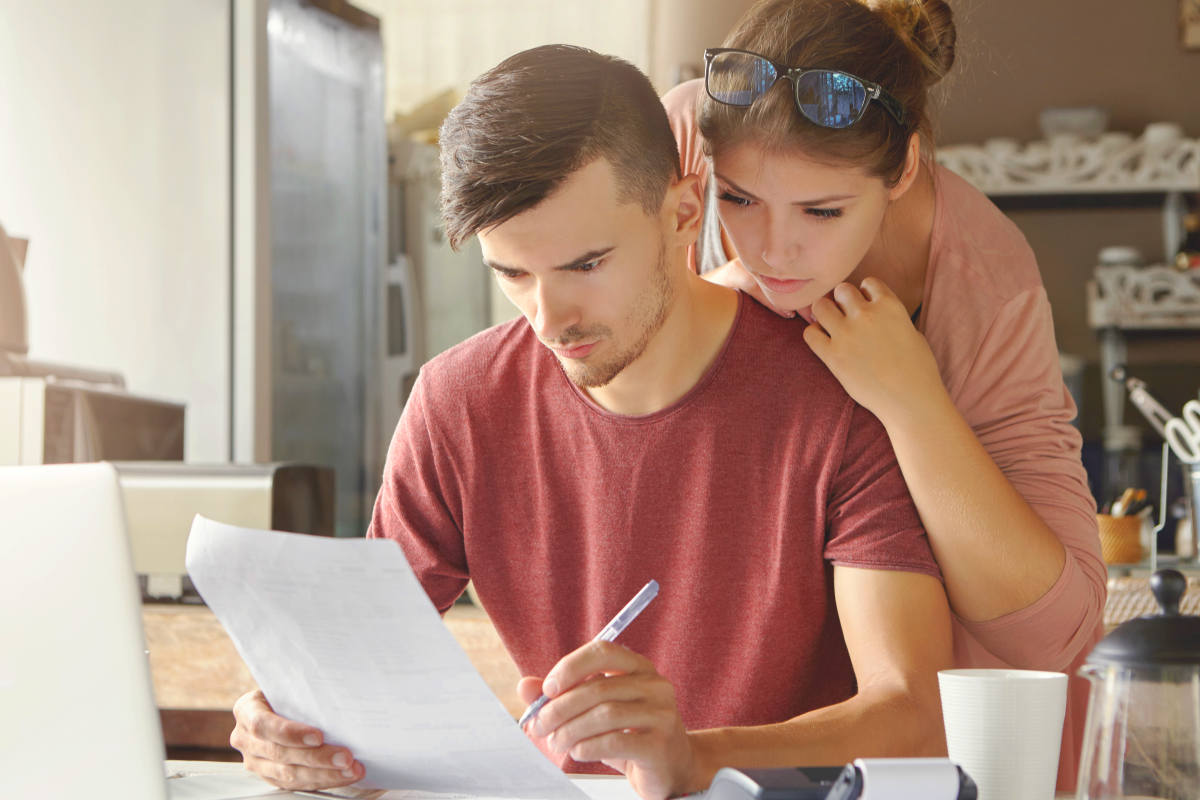 Family managing domestic finances at home | Smart Financial Goals To Set Before You Turn 40 | financial priorities