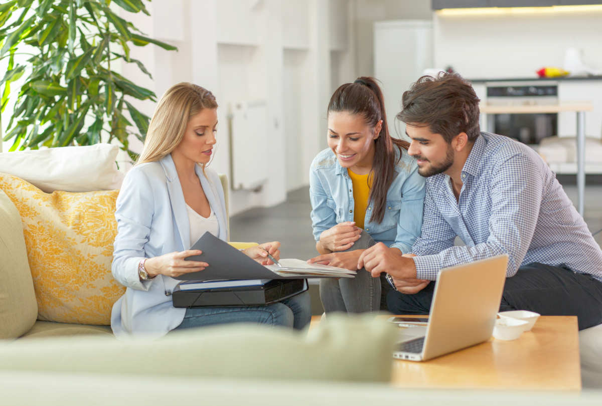 Female Real Estate agent offer home ownership and life insurance to young couple | Smart Financial Goals To Set Before You Turn 40 | personal finance management tips