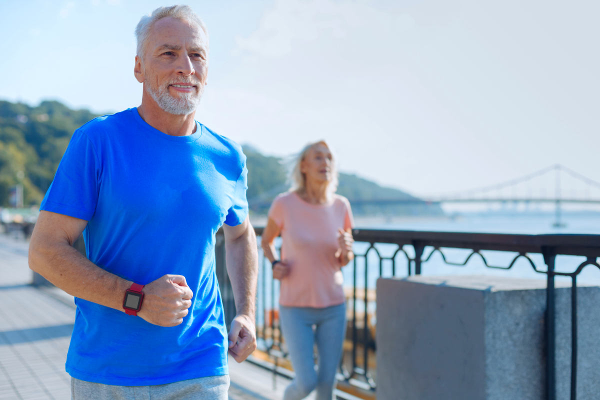 Fit senior man jogging together with his wife | Good Lifestyle Habits Baby Boomers Should Adopt | good habits | healthy lifestyle changes