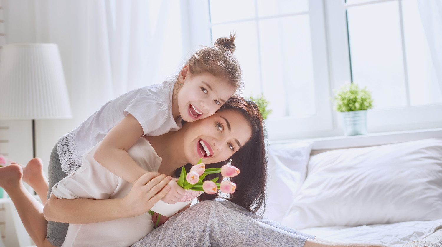 Child daughter congratulates mom and gives her flowers tulips and postcard   Working Moms Tips: Balancing Work and Family   full time working mom   Featured