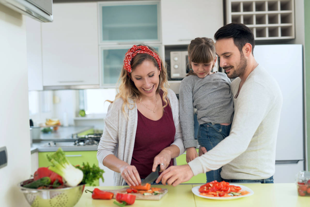 Happy young family preparing lunch in the kitchen | How to Become a Cool Working Dad | working father