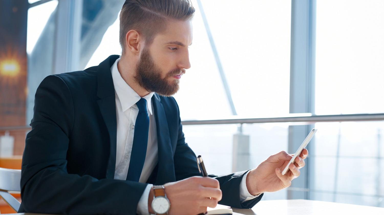 Modern hipster businessman using mobile phone | Social Media Etiquette Tips For Smart & Responsible Social Networking | network etiquette | Featured