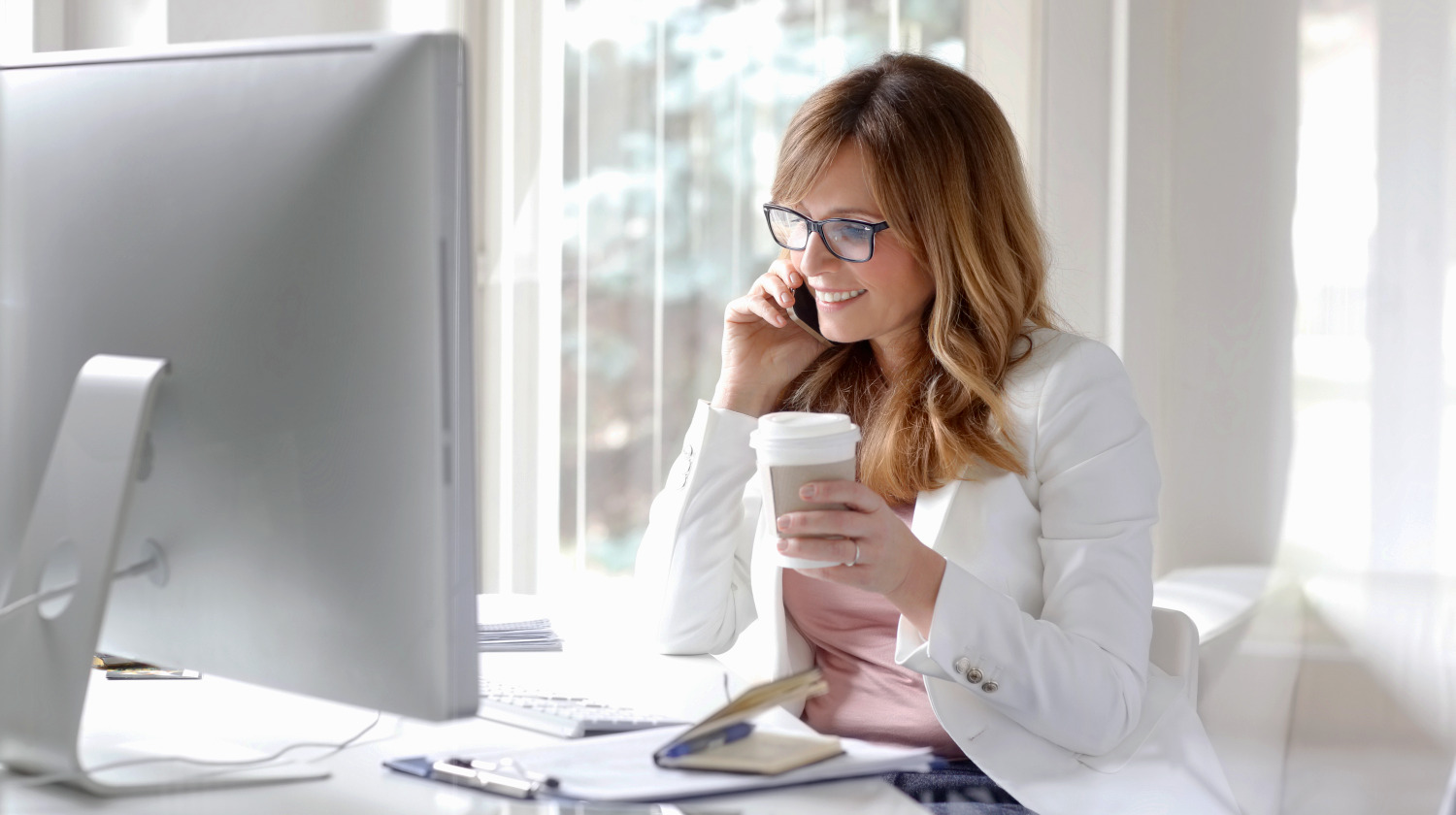 portrait-beautiful-executive-businesswoman-making-call   How To Handle Career Change In Your 50s (And Beyond)   Career Change at 50   best career change jobs at 40   Featured
