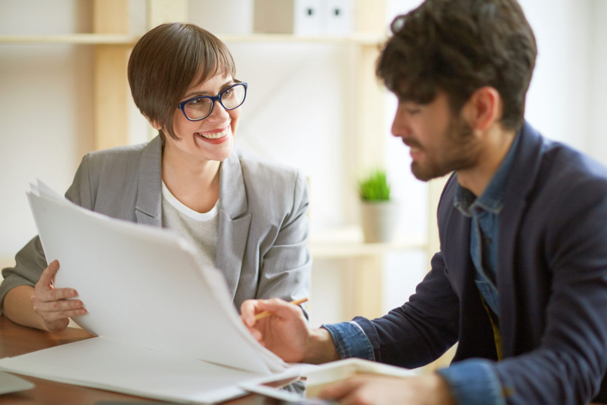 Portrait of two successful business people communicating | Ways To Give Constructive Feedback To Help Your Employees Grow | constructive feedback for managers examples