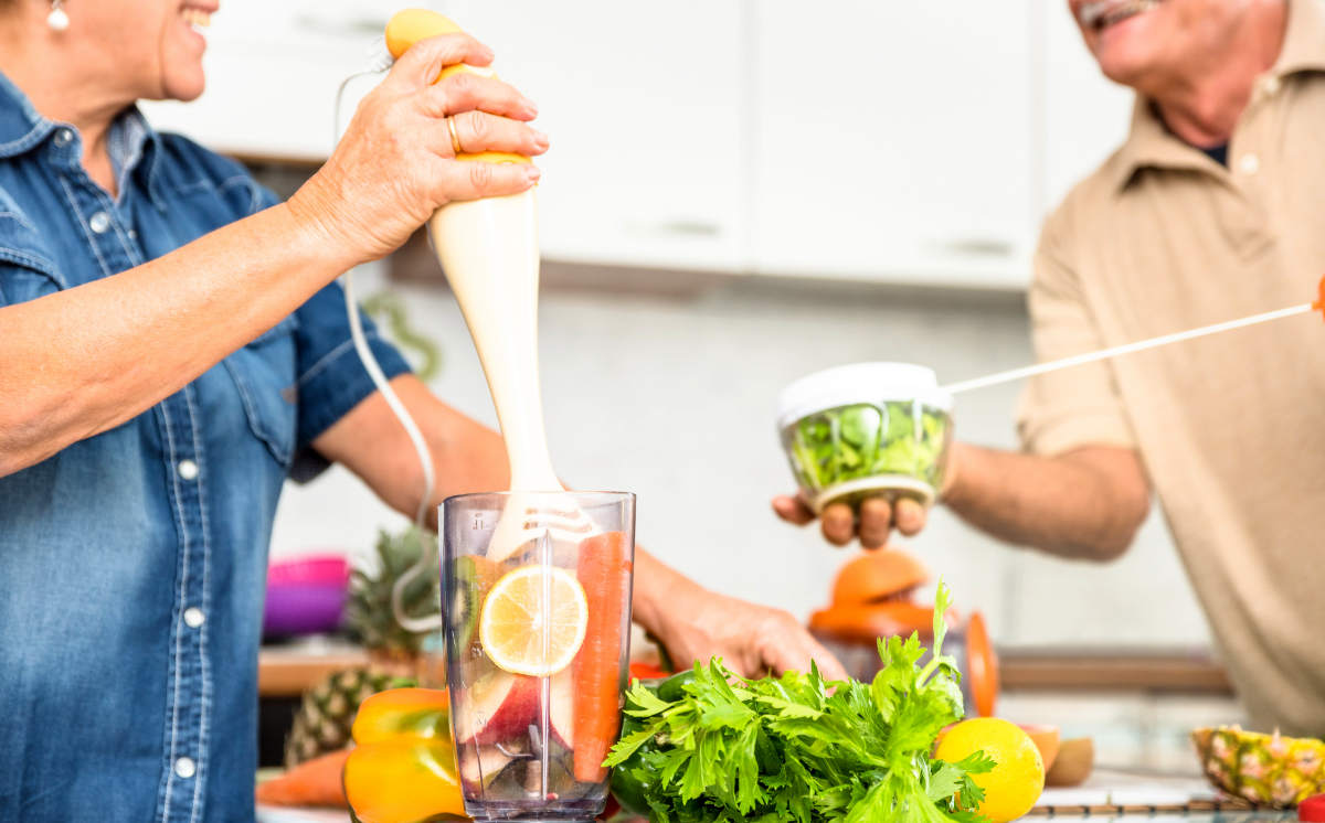 Senior couple having fun in kitchen with healthy food | Good Lifestyle Habits Baby Boomers Should Adopt | good habits | healthy lifestyle