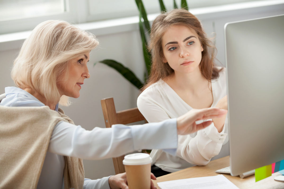 Senior and young female colleagues discuss online project look at pc screen | Ways To Give Constructive Feedback To Help Your Employees Grow | how to give constructive feedback