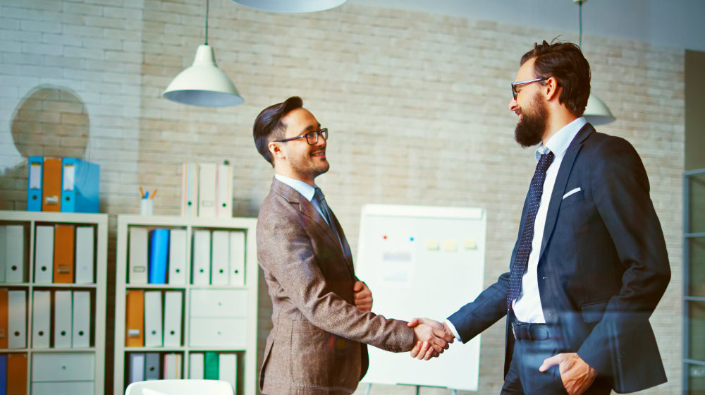 Successful businessmen handshaking after negotiation | Top Business Advice From Successful Business Owners | small business advice | Featured