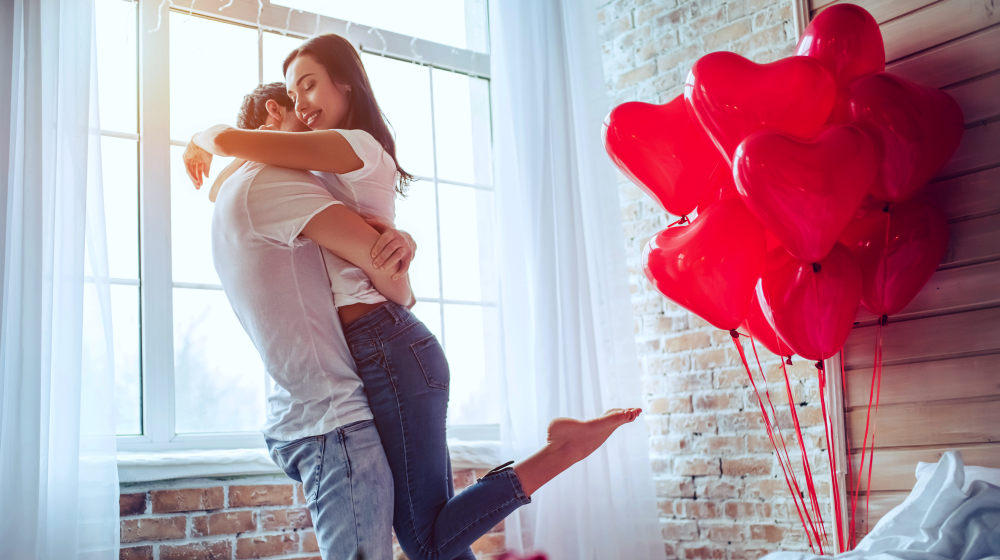 Couple hugging, kissing and enjoying spending time together | How To Be Better In Bed For Romantic Love-Making | Romantic Love Making | how to be romantic in bed | Featured