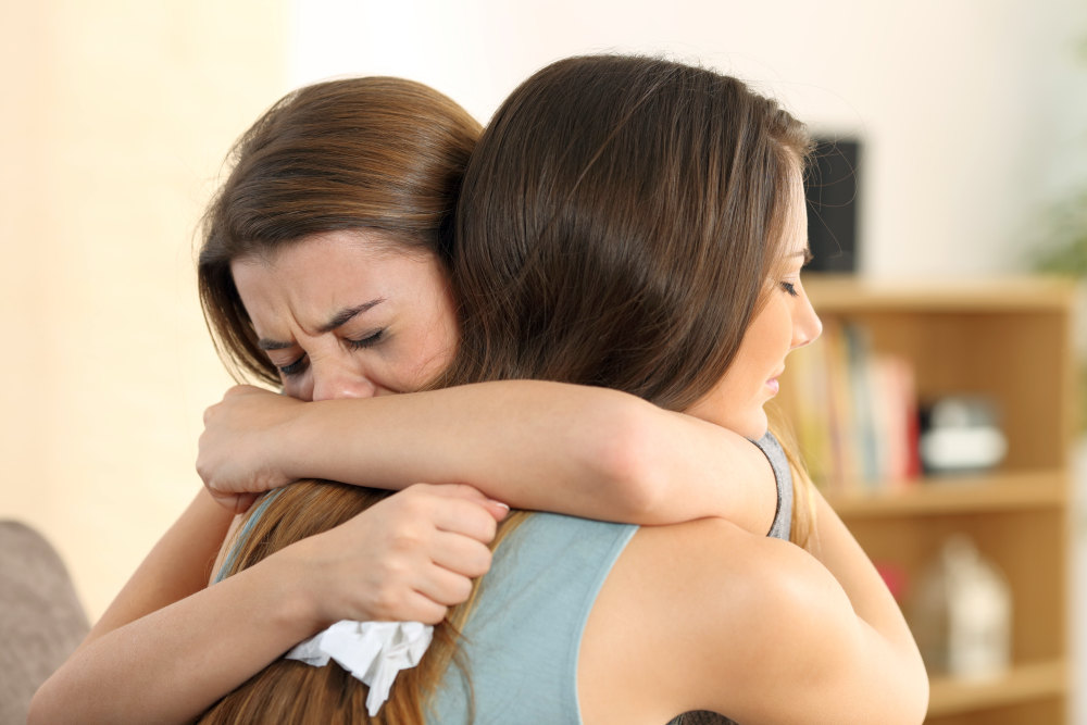 Girl embracing to comfort to her sad best friend | How To Cheer Someone Up: Simple Ways | quotes to cheer someone up