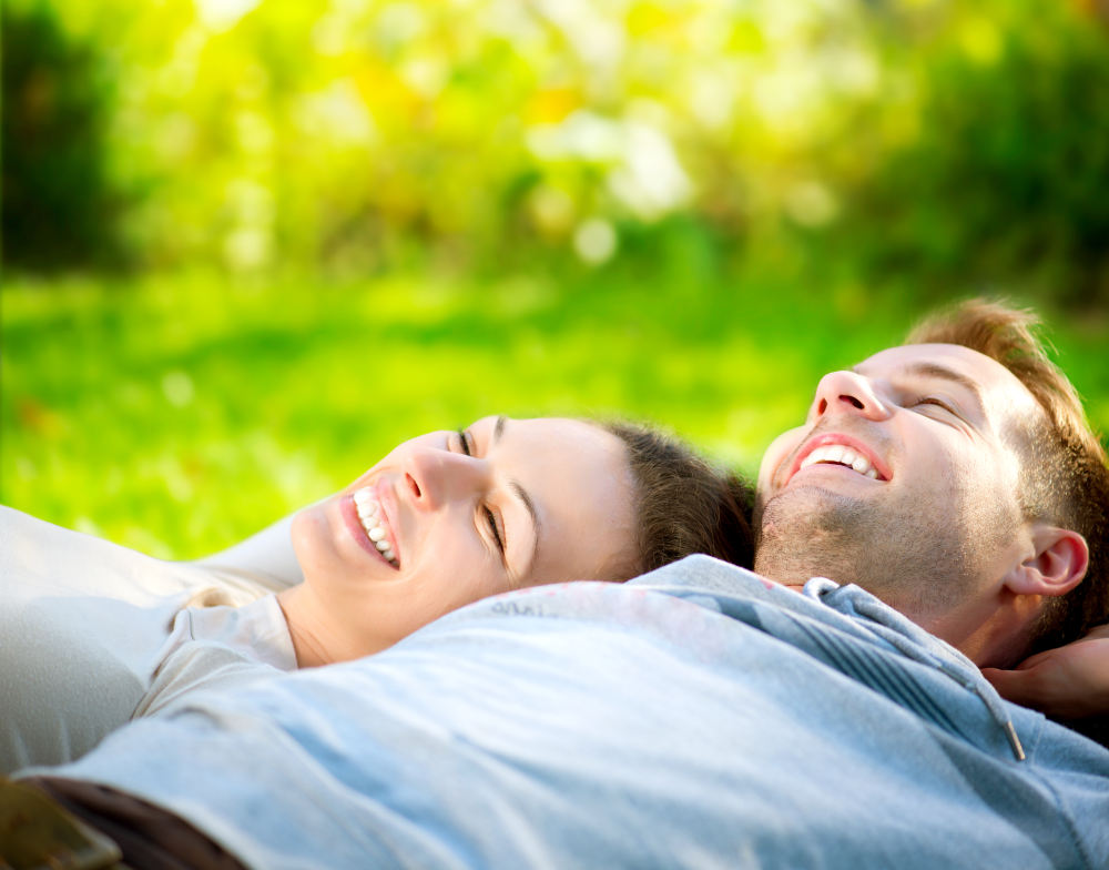 Happy Smiling Couple Relaxing on Green Grass   Things In Life To Be Thankful For Every Day   things to be thankful for   funny things to be thankful for
